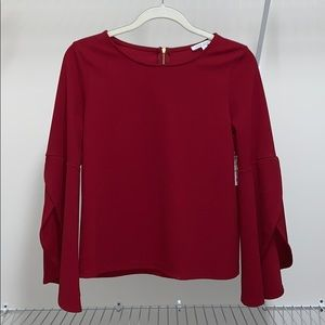 Red women's blouse with wide sleeves